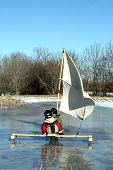 Two Young Boys Sailing On An Ice Boat
