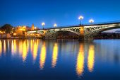 SEVILLE, SPAIN - MAY 15: The Isabel II bridge of Seville, also known as the Triana Bridge, in early