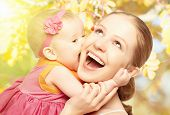 Happy Cheerful Family. Mother And Baby Kissing In Nature Outdoors
