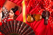 Flamenco woman with bullfighter and typical Spain Espana elements like castanets fan and comb