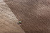 A tractor raking a ploughed field in preperation for sowing the years crop.