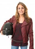 Young female biker holding a crash helmet