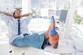 Designer relaxing at desk with no shoes and stripey socks