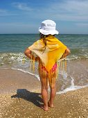 Girl Standing At The Seacoast