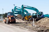 Excavators And Asphalt Compactor Truck