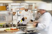 stock photo of oven  - Busy chefs at work in the restaurant kitchen - JPG