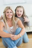 Little girl about to giver her mother a fright on floor of living room