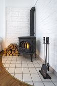 foto of cozy hearth  - Old fireplace in modern interior design  - JPG