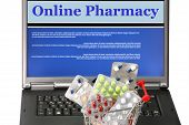 stock photo of viagra  - Online pharmacy collage in laptop with trolley filled with pills - JPG