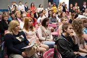 MOSCOW - MAY 22: Unidentified people listen to speech at graduation