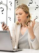image of pissed off  - picture of confused woman with cell phone - JPG