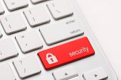 stock photo of keyboard  - Red security button on the keyboard - JPG