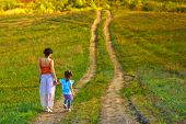 mother woman little girl my daughter go on rural road through gr