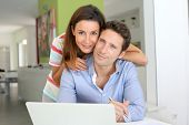 stock photo of internet-banking  - Couple at home looking at bank account on internet - JPG