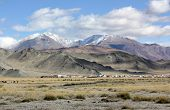 pic of yurt  - Inner Mongolia yurt in the grass land with mountain in background - JPG