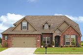 foto of garage  - Luxury home in expensive neighborhood with curb appeal - JPG