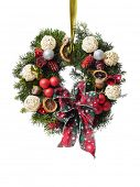 Christmas wreath with decorations and ribbon bow isolated on white