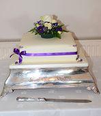 Simple purple & white wedding cake