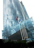 stock photo of waste reduction  - Office building in Riga with flags of European countries - JPG