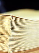 picture of manila paper  - Stack of yellow manila envelopes closeup background - JPG