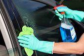 foto of window washing  - A man washing a car - JPG