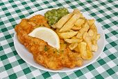 Fish And Fries With Peas In Diner.