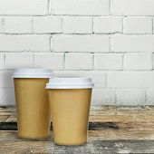 Coffee Cups On Wooden Table