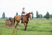 Beautiful Blonde Woman Riding Horse Bareback