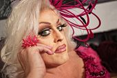 foto of drag-queen  - Close up of serious drag queen in blond - JPG