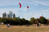 Composite Of Multiple Kites Flying Set Against City Skyline