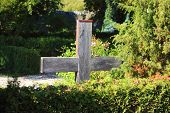 image of urn funeral  - Simple wooden cross at an old graveyard in Denmark - JPG