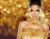 stock photo of mulatto  - Fashion Beauty Girl Isolated on golden bokeh Background - JPG