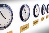 stock photo of analog clock  - Timezone clocks showing different times of world locations - JPG