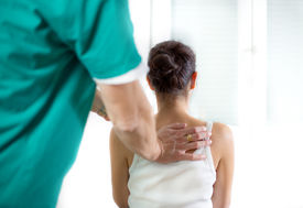 stock photo of chiropractor  - Chiropractor massage the female patient spine and back - JPG