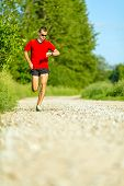 Man Trail Running On Country Road