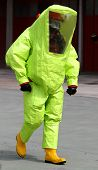 Person With Anti Radiation Suit Yellow And Yellow Rubber Boots To Guard Against The Risk Of Bacterio