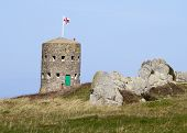stock photo of martello  - The British built 15 Guernsey loophole towers at various points along the coast of Guernsey to deter
