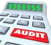 Audit word on a calculator financial book keeper accountant reviewing money irregularity