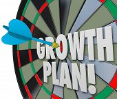 Growth Plan words on a dart board and targeting or aiming for increase or improvement