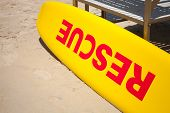 Small Yellow Rescue Boat Lays On Sandy Beach