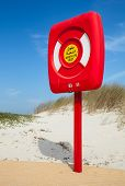 Safety Life Buoy In Red Case Stand On The Beach In Saudi Arabia