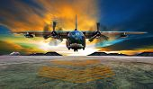image of c130  - military plane landing on airforce runways against beautiful dusky sky - JPG