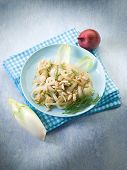 salad with sauteed endive onions and pine nuts