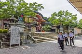High School Students Wearing School Uniforms At Fushimi Inari Shrine In Kyoto, Japan