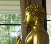 Left Side Of Golden Monk Statue