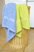picture of dirty-laundry  - Dirty clothes basket with towels waiting for laundry - JPG