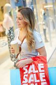 image of takeaway  - Female Shopper With Takeaway Coffee In Mall - JPG