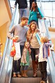 picture of escalator  - Family On Escalator In Shopping Mall Together - JPG