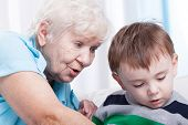 foto of grandma  - Horizontal view of glad grandma with little boy - JPG