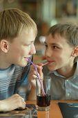 boys drinking coke